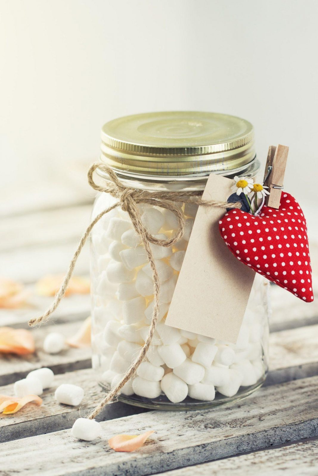 Jar with marshmallow and red plush heart. Love, sweet or valenti