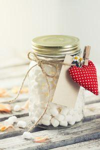 Jar with marshmallow and red plush heart. Love, sweet or valentine's day concept, vintage toning
