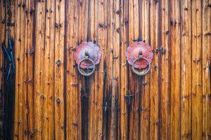 closeup of the antique oriental door knocker,Lishui city,china.